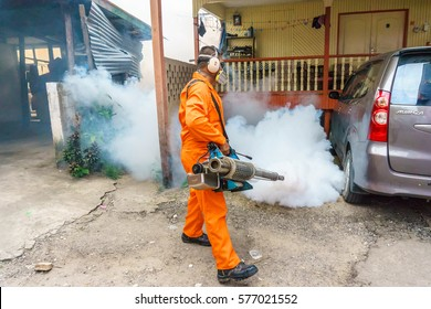 KOTA KINABALU SABAH, MALAYSIA - FEB 10, 2017: Unidentified man work fogging to eliminate mosquito for preventing spread dengue fever and zika virus