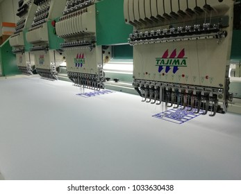 Kota Kinabalu, Sabah , Malaysia - February  : Embroidery machine brand TAJIMA with 4 head machine and 12 needle color are embroidery Logo at Textile Industry at Garment Manufacture