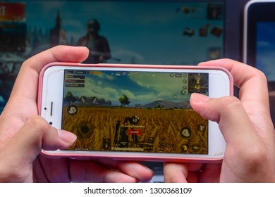 Kota Kinabalu Sabah, Malaysia - Jan 23, 2019: A hand holding a smartphone playing PUBG games online. Screen shows player taking painkillers to heal health. Multimedia games are famous among students.
