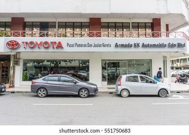 KOTA KINABALU SABAH, MALAYSIA - JAN 07, 2017: The sign of Toyota, the largest automobile manufacturer in 2012, and Scion, a marque of Toyota, is displayed in front of the car dealer.