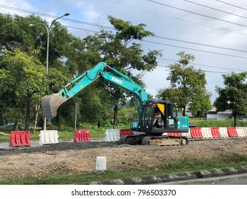 Kota Kinabalu Sabah Malaysia - Jan 18, 2018: Excavator working at flyover construction site. The Pan Borneo Highway linking Sabah, Brunei, Sarawak and Kalimantan is expected to be completed in 2025.