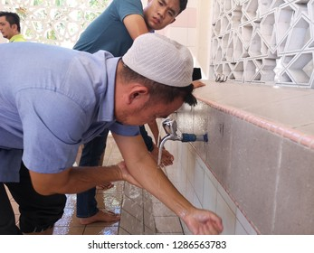 KOTA KINABALU, SABAH, MALAYSIA - January 11, 2019 : Unidentified Muslim men ready to take ablution outside mosque. This ritual purification is a must before performing a prayer. - Image
