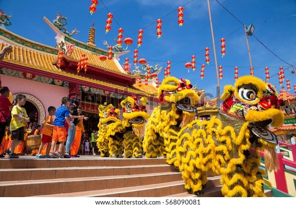 Kota Kinabalu, Sabah , Malaysia - January 27, 2017 : Lion dance show in chinese new year festival on 1st day Chinese new year on Peak Nam Toong , Kota Kinabalu Sabah, Malaysia