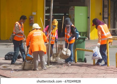 Kota Kinabalu Sabah Malaysia - Jul 2, 2017 : Workers picking up litter at street of Kota Kinabalu Sabah after an event to maintain cleanliness. Kota Kinabalu is the capital city of Sabah state.