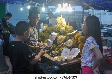 Kota Kinabalu Sabah Malaysia - Jul 13, 2017 : Fruits vendor selling durian at Segama night market. Durian is famous for its strong smell creamy taste and popular among tourist from China.