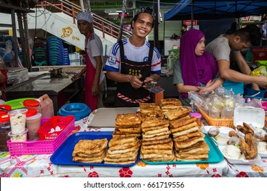 Kota Kinabalu Sabah Malaysia - Jun 01, 2017 : Food Vendor happy during sale food for Ramadan Season before fasting hour