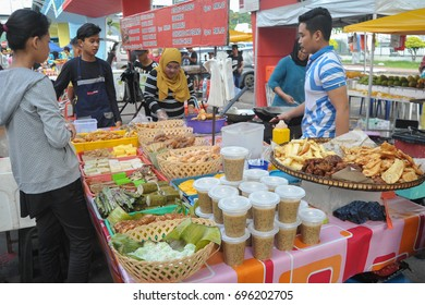 Kota Kinabalu Sabah Malaysia - Jun 4, 2017 : People buying food at street stall in Kota Kinabalu. Street food is popular among local for its variety, taste and reasonable price.