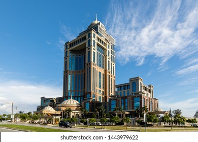 Kota Kinabalu, Sabah, Malaysia - June 26 2019: Sabah State Administrative Centre, overlooking Likas Bay. The 33-storey office tower is the tallest building in Borneo.