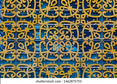 Kota Kinabalu, Sabah, Malaysia - June 9 2019: Closeup of the facade of Sabah Regional Library at Tanjung Aru Plaza, incorporating motifs of Sabah's ethnic communities into its design.