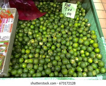 Kota Kinabalu, Sabah, Malaysia - June 24, 2017 : Fresh local calamansi or limau kasturi (citrus microcarpa) that can be found sale at Pasar Besar Kota Kinabalu ( Kota Kinabalu Central market ).