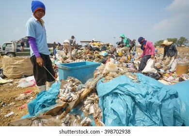 Kota Kinabalu Sabah Malaysia - Mar 21, 2016 : Scavengers collecting recyclable material at dumping site in Sabah.Rubbish segregation is hardly impose in Malaysia beside many campaign by government.