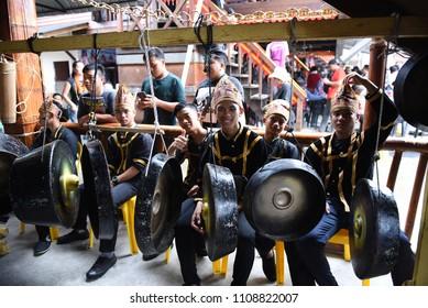 Kota Kinabalu, Sabah , Malaysia - MAY 31, 2018: A man playing a traditional instrument gong during during Pesta Kaamatan. Pesta Kaamatan is a Harvest Festival celebrated yearly.