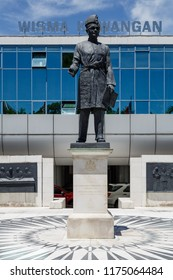 "Kota Kinabalu, Sabah, Malaysia - May 5 2015: Tunku Abdul Rahman Monument on the compound of the Ministry of Finance (MOF). The inscription titles him ""Bapa Malaysia"" (malay. for ""Father of Malaysia"")"