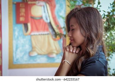 Kota Kinabalu, Sabah, Malaysia : May 17, 2017 - Beautiful Asian Chinese woman was in praying at temple Kota Kinabalu, Sabah, Malaysia