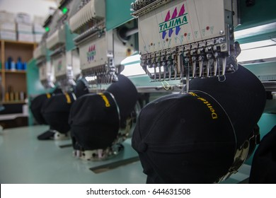 Kota Kinabalu, Sabah , Malaysia - May 02, 2017 : Embroidery machine are embroidery wording on cap in Textile Industry at Garment Manufacturers