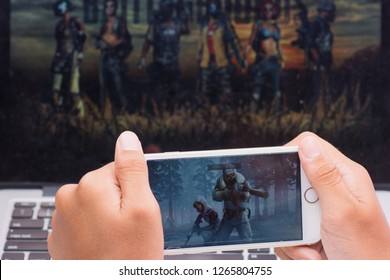 Kota Kinabalu Sabah Malaysia - Nov 22, 2018: A boy's hand holds and plays a Player Unknown Battlegrounds game on mobile phone. Educators should use interactive and media-rich learning tools.