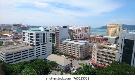 Kota Kinabalu, Sabah / Malaysia - October 29, 2017: View overlooking buildings and the sea from Signal Hill Observatory in KK