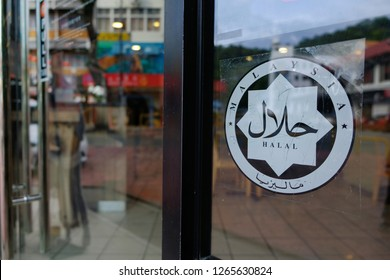 Kota Kinabalu, Sabah, Malaysia. Photo of halal signage outside eatery shop. Halal,refers to what is permissible or lawful in traditionalIslamic law. It is frequently applied to permissible food.