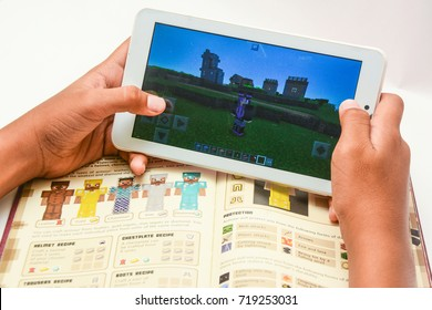 Kota Kinabalu Sabah Malaysia - Sept 20,2017:Minecraft game plays on mobile phone.Educators encourage to re-design their educational curriculum into an interactive and media-rich learning environment.