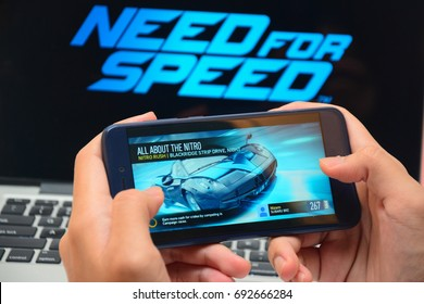 Kota Kinabalu Sabah Malaysia-Aug 8,2017: Need For Speed game plays on mobile phone.  Educators encourage to re-design educational curriculum into an interactive and media-rich learning environment