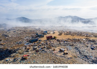 Kota Kinabalu, Sabah, Malaysia-March 04, 2020 : 4K aerial image of Dump truck and workers offloading trash at landfill. Plastic pollution environmental problem in Kayu Madang Kota Kinabalu Sabah.
