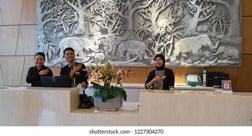 Kota Kinabalu, Sabah Malaysia-Nov 12, 2018: Hoteliers gesturing to incoming guests arriving at the Soluxe Hotel in Putatan.