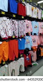 Kota Kinabalu, Sabah - May 19th , 2017 : various brands and sizes of children's clothing on shelf in supermarket.