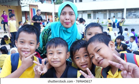 Kota Kinabalu, Sabah. November 11, 2017: Teacher and students in Malaysia. Positive teacher-students relationship is important and has long-lasting impact in students' academic and social skills.