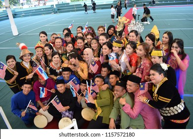 Kota Kinabalu, Sabah-Aug 16, 2018: Clad in the traditional attire of the people of Borneo, they wave the Malaysian flag to commemorate the Merdeka Day celebration which will be on Aug 31.