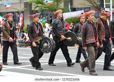 Kota Kinabalu, Sabah-Aug 31, 2018: The Runggus ethnic people of Sabah taking part in the parade of the National Day celebration.
