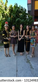 Kota Kinabalu, Sabah-Feb 14, 2019:The rich traditional costumes of the Sabahan people worn by (left to right) Dina Chong who wears the Kadazan Papar attire, Clarissa Jane Ahap who is clad in th