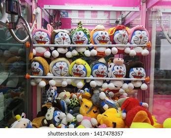KOTA KINABALU, SABAH,MALAYSIA - 6 JUNE 2019: Figures of Doraemon on store shelf. Doraemon is a Japanese manga series written and illustrated by Fujiko F. Fujio.