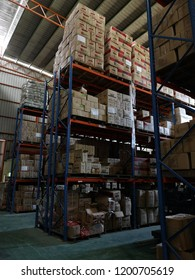 KOTA KINABALU, SABAH,MALAYSIA-October 11, 2018 : Rows of shelves with goods boxes in modern industry warehouse store at factory warehouse storage