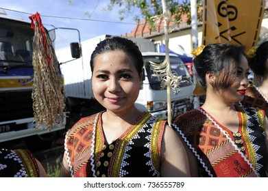 Kota Kinabalu,Malaysia-May 30,2016:Beautiful girl from Dusun Lotud Tuaran ethnic in their traditional costume pose for the camera during the Sabah State Harvest festival celeberation in Kota Kinabalu.