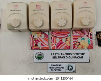 KOTA KINABALU,MALAYSIA-OCT 25,2019: Switch fan and Switch light and circuit breaker. Electric switches with multiple switches are mounted on the wooden walls. switch panel for control the orbit fan in