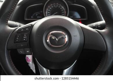 Kota Kinabalu,Sabah, MALAYSIA - JANUARY 15, 2019 : View of MAZDA steering and meter. Focus on MAZDA logo, Black Steering Wheel And Silver