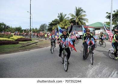 Kota Kinabalu,Sabah-Aug 31,2017:Cyclists all age and gender with Malaysia flag ready for National day parade,celebrating the 60th anniversary of independence on 31st Aug 2017 at Kota Kinabalu,Sabah