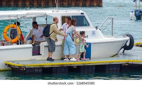 Kota Kinabalu,Sabah-Dec 12,2018:Group of tourists arrived from Manukan island in the boat jetty,Kota Kinabalu,Sabah.Manukan is the most popular & beautiful island in Sabah Kota Kinabalu.