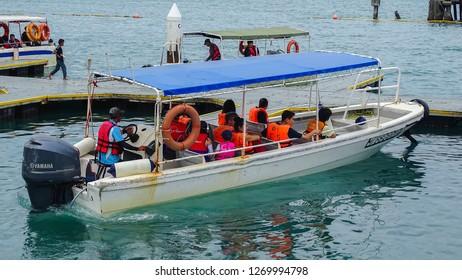 Kota Kinabalu,Sabah-Dec 12,2018:Group of tourists on the boat ready to the Manukan island in Kota Kinabalu,Sabah.Manukan island is the most popular & beautiful island in Sabah Kota Kinabalu,Malaysia.