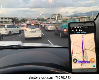 KOTA KINABALU,SABAH,MALAYSIA-Jan 10,2018: - GPS application Waze running on Samsung Note 4 in a car. Waze is one of the most popular GPS applications.