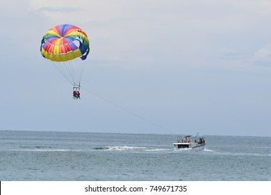 Kota Kinabalu,Sabah-Nov 5,2017: Parasailing in a blue sky near sea beach. Parasailing is a popular recreational activity among tourists in Tanjung Aru,Sabah. For editorial use only.