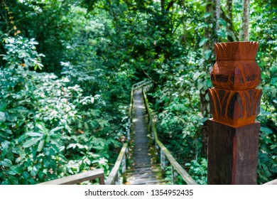 Kota Kinabatangan, Sabah, Malaysia - Juli 27 2014: carved wood pillar along the walkway through the jungle to the Gomantong Caves, a traditional place for harvesting birdnests