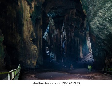 Kota Kinabatangan, Sabah, Malaysia - July 27 2014: Inside the gloomy Gomantong Caves, the floor covered with the dirt of swallows and bats. The precious birdnests are glued at the cave's ceiling.