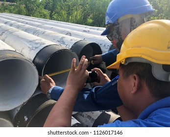 Kota Tinggi, Johor - 3rd July 2018 : Pipe inspector together with helper was checking diameter of MSCL pipe before welding.