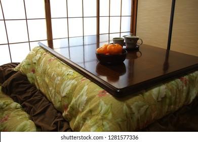 Kotatsu and Mandarin orange An orange is eaten at a Japanese-style room. I have tea at a Japanese-style room.
