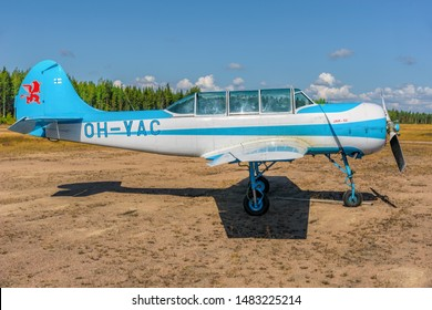 KOTKA, FINLAND - Aug 10, 2019: Two-seat single-engined piston-powered Yakovlev Yak-52 primary aerobatic trainer aircraft OH-YAC parked on Karhula aviation museum airshow.