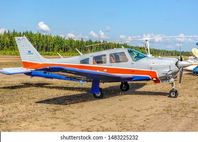 KOTKA, FINLAND - Aug 10, 2019: Four-seat light all-metal single-engined piston-powered airplane Piper PA-28R-201 Cherokee Arrow III OH-PEA parked on Karhula aviation museum airshow.