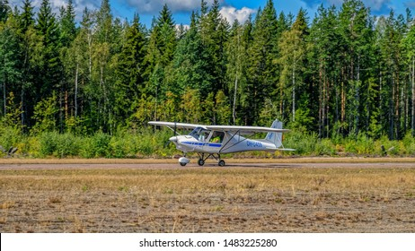 KOTKA, FINLAND - Aug 10, 2019: Two-seat single-engined piston-powered general aviation microlight aircraft Ikarus C42B OH-U459 landing on Karhula aviation museum airshow.
