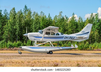 KOTKA, FINLAND - Aug 10, 2019: Single-engined piston-powered aircraft with fixed landing gear Cessna T206H Turbo Stationair OH-PAX amphio floats landing on wheels on Karhula aviation museum airshow.