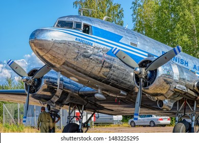 KOTKA, FINLAND - Aug 10, 2019: Short-haul transport aircraft with two piston engines Douglas DC-3A-447 OH-LCH Airveteran in Finnish Airlines livery parked on Karhula aviation museum airshow.